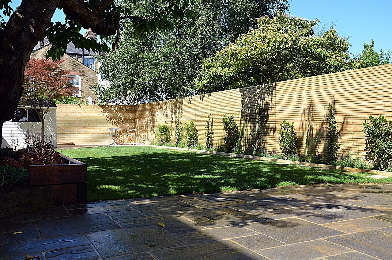 Artificial grass planting softwood trellis path paving London Clapham Balham Wandsworth