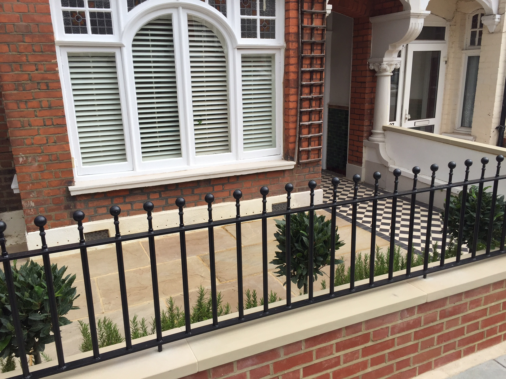 Front garden brick red wall metal gate rails planting Balham Clapham Wandsworth Earsfield London