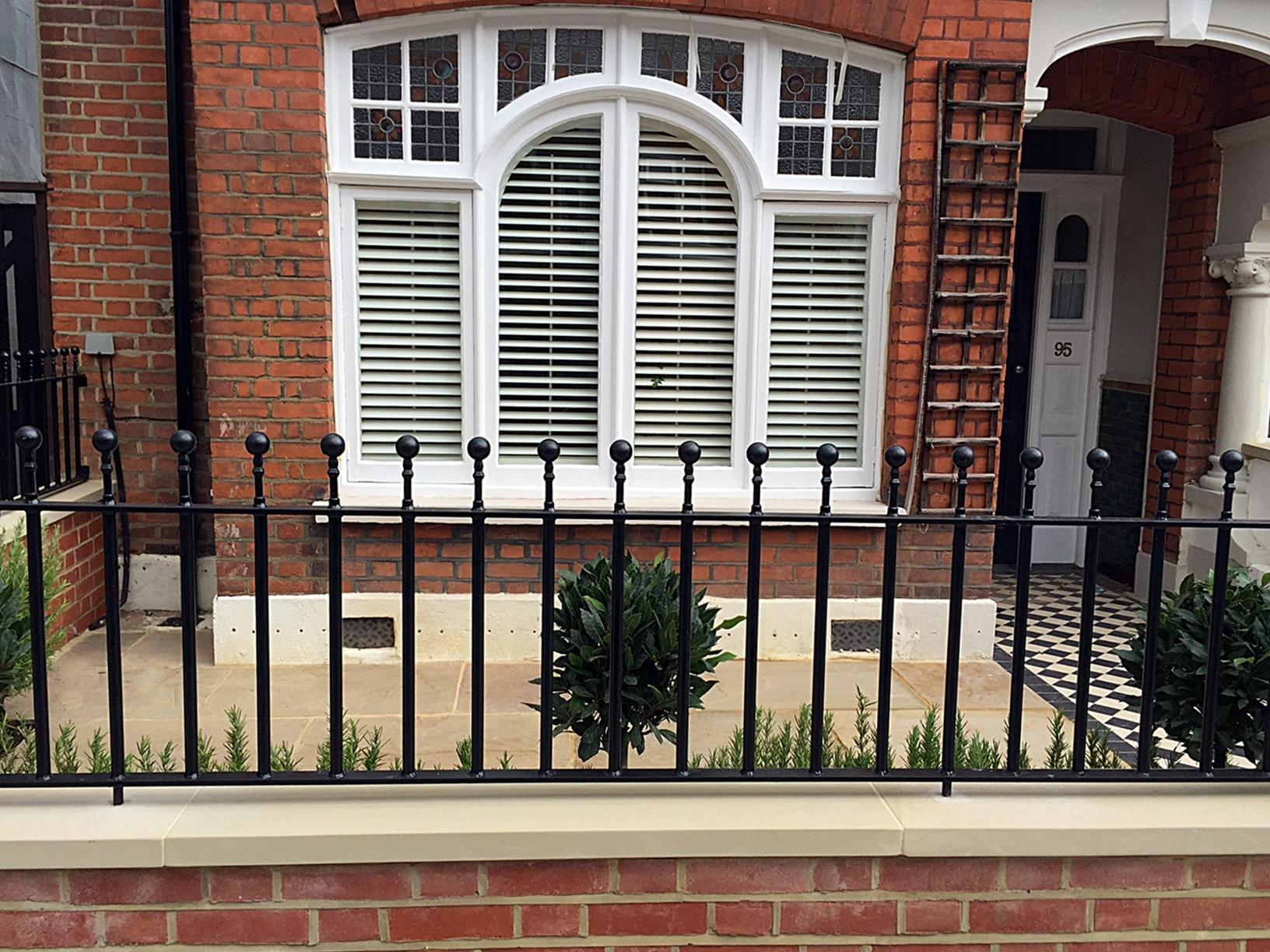 Low maintenance cap coping red brick garden front wall metal gate rails plants London Balham Streatham Brixton Vauxhall