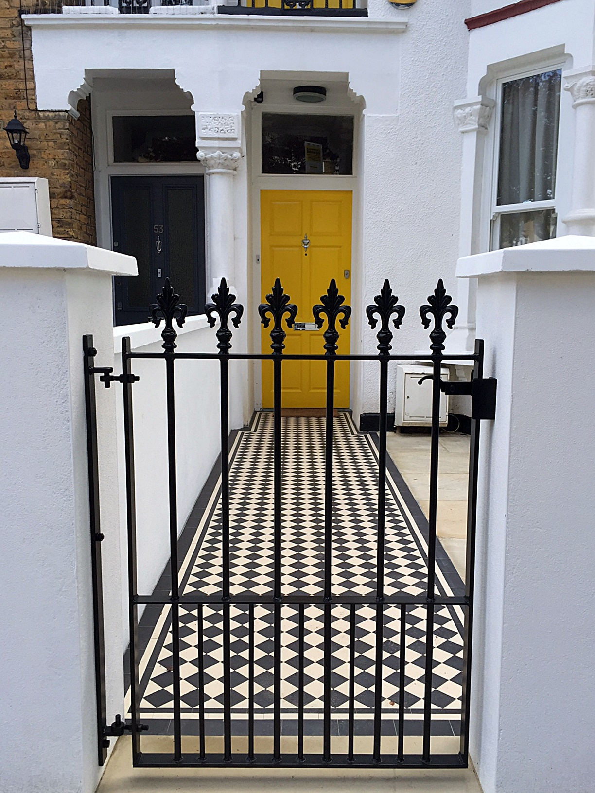 Metal gate rails white render wall front garden Victorian mosaic path tile London Balham Clapham Wandsworth