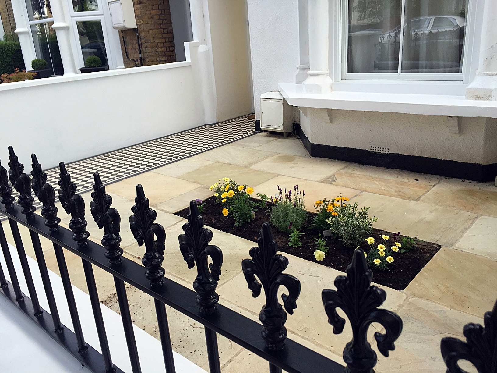 Metal gate rails white render walls path paving tiles London stone Balham Wandsworth Battersea Clapham