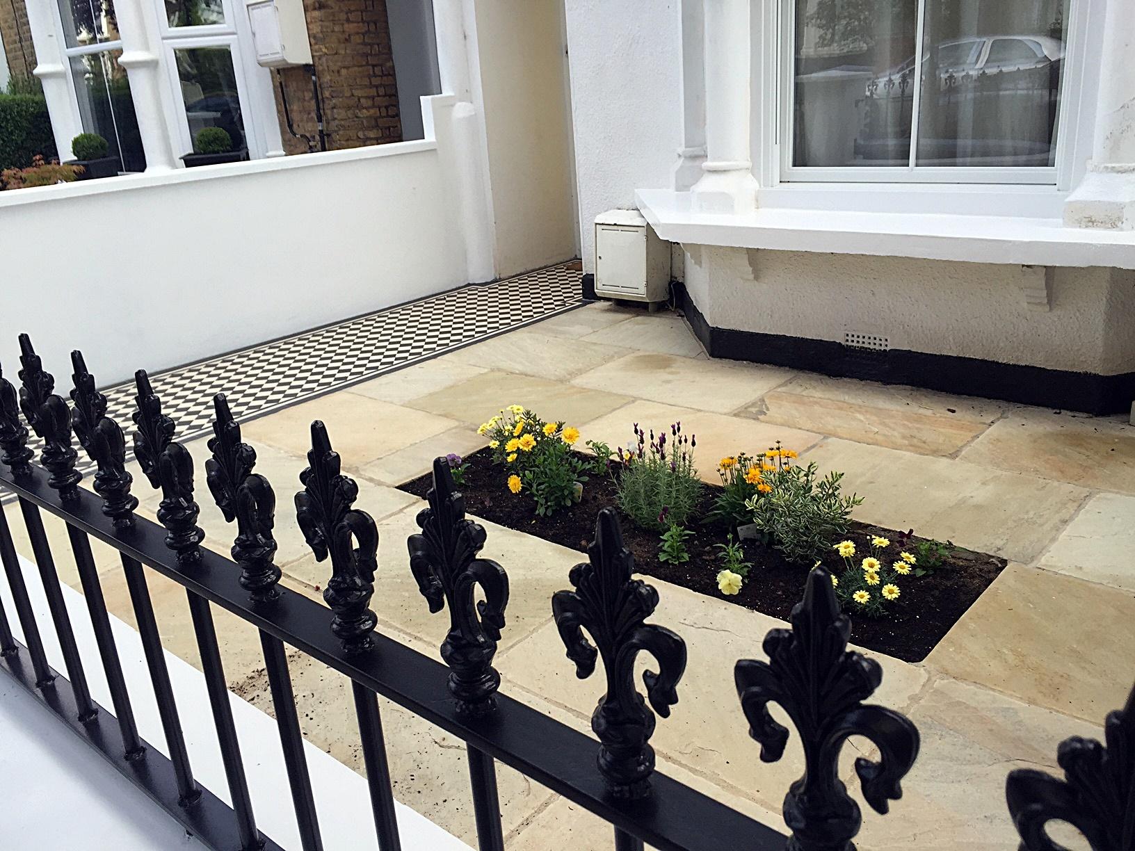 Metal gate rails white render walls path paving tiles London stone Balham Wandsworth Battersea Clapham
