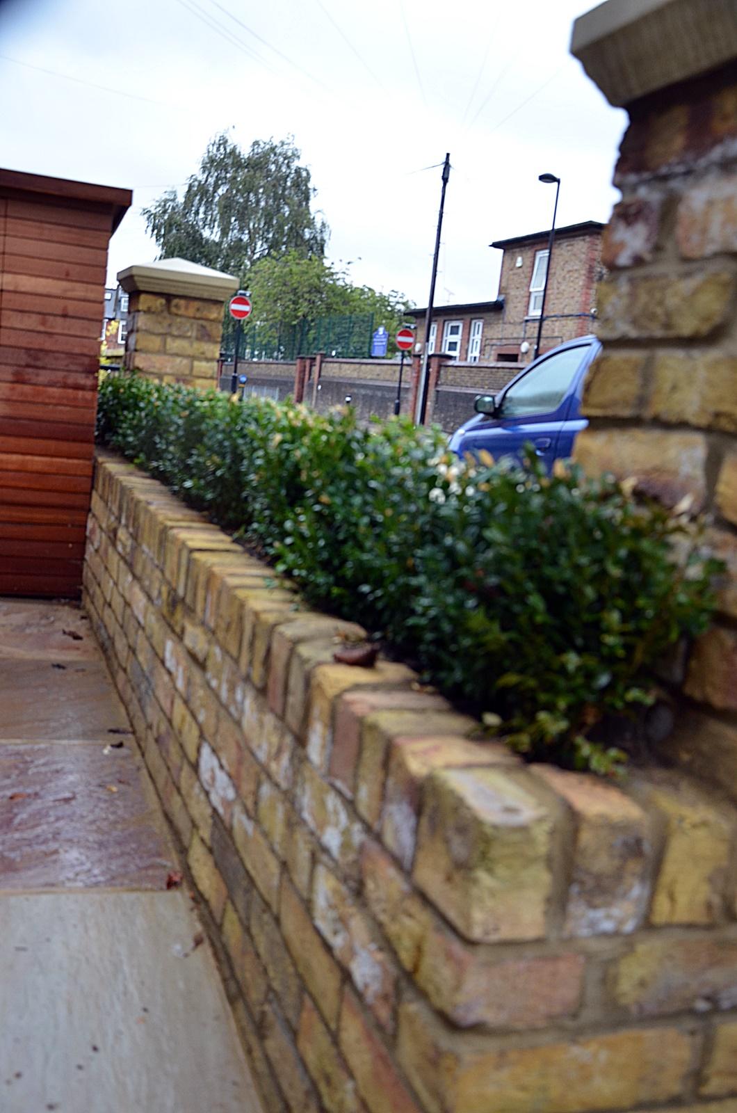 brick-garden-wall-planting-sandstone-paving-bespoke-storage-front-garden-london-fulham-chelsea-kensington