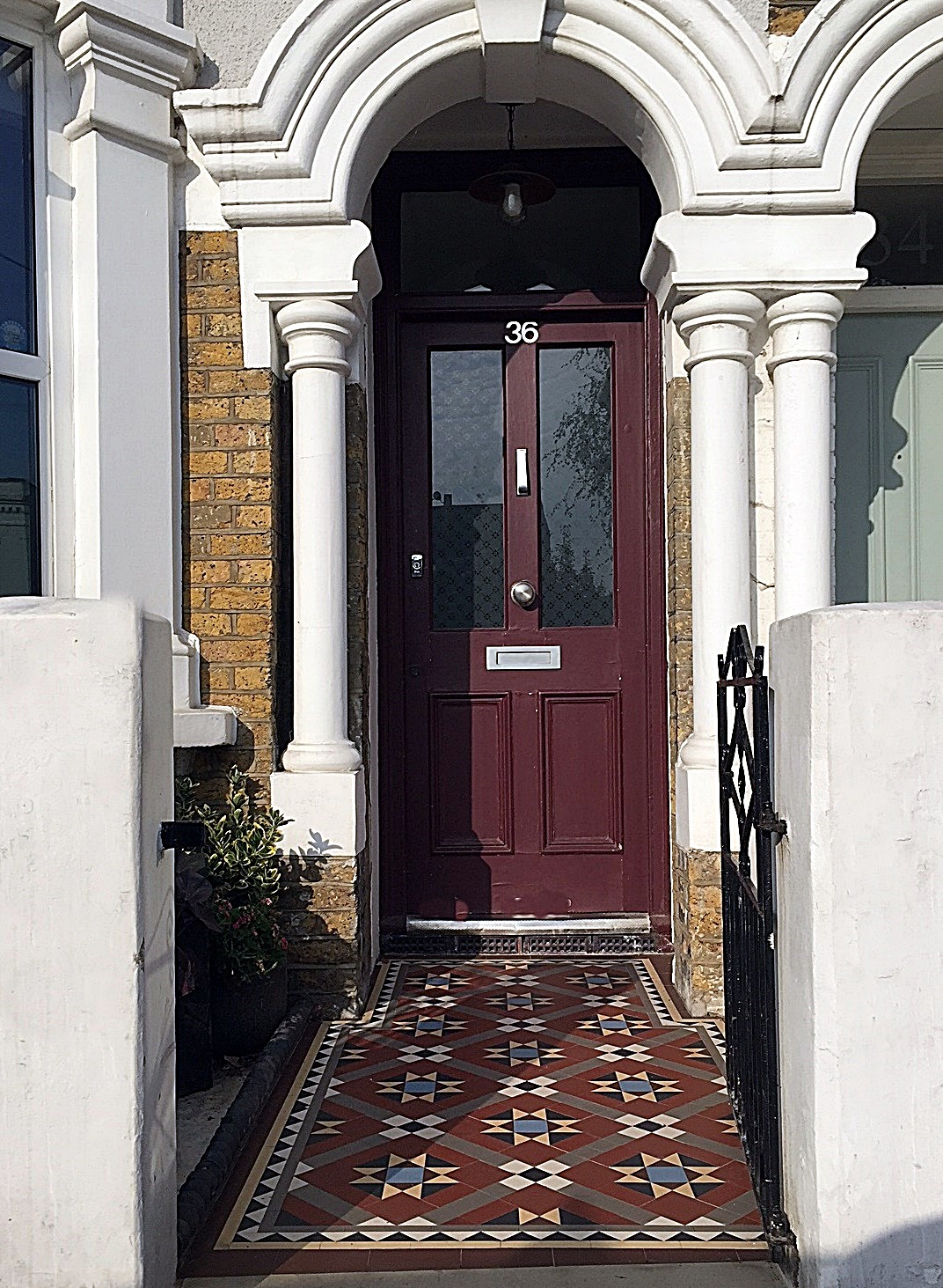 Front metal gate tile mosaic low maintenance York stone entrance London Streatham Clapham Balham