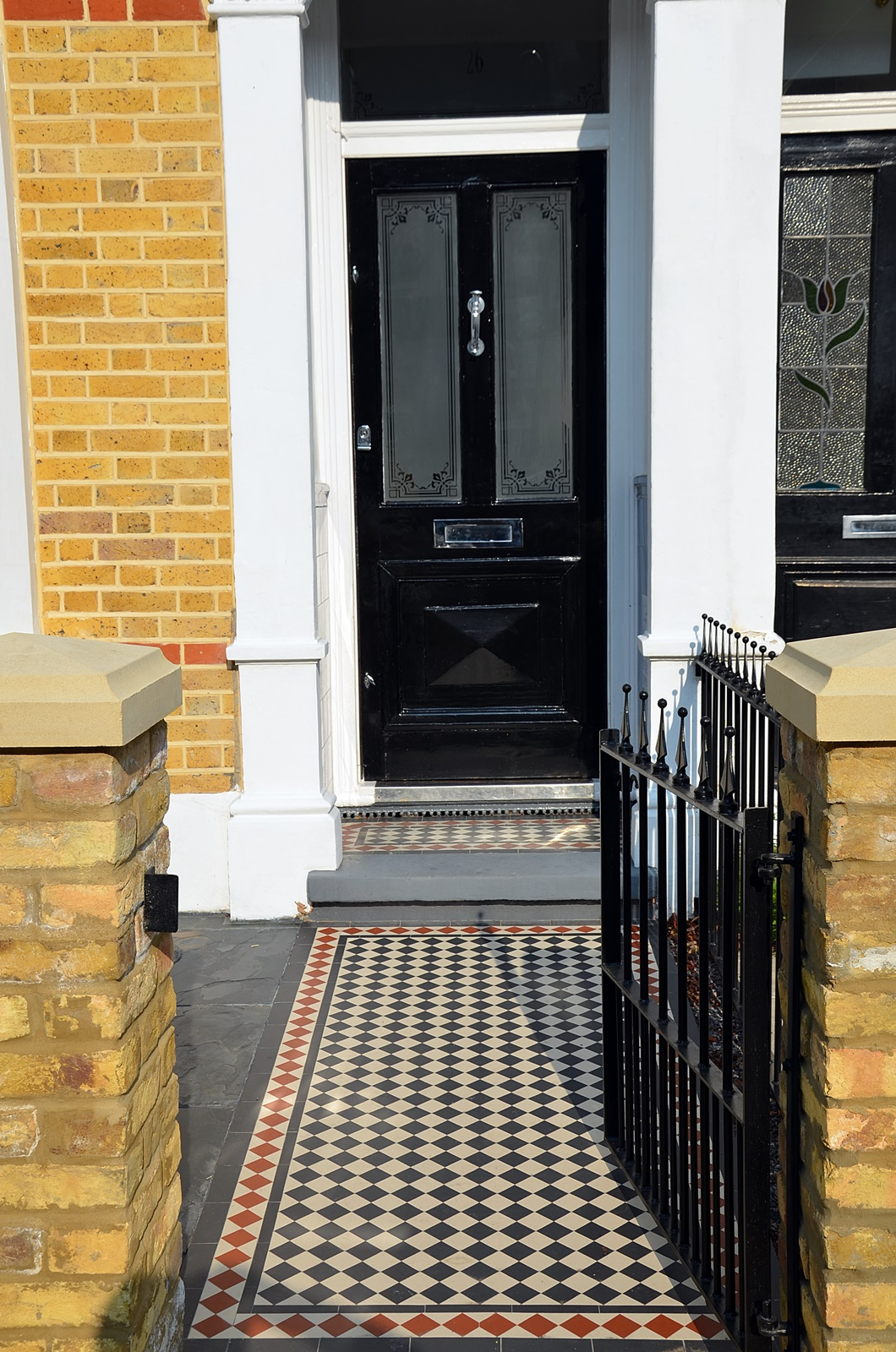 wrought-iron-gate-multi-colour-mosaic-path-paving-london-chelsea-fulham-kensington