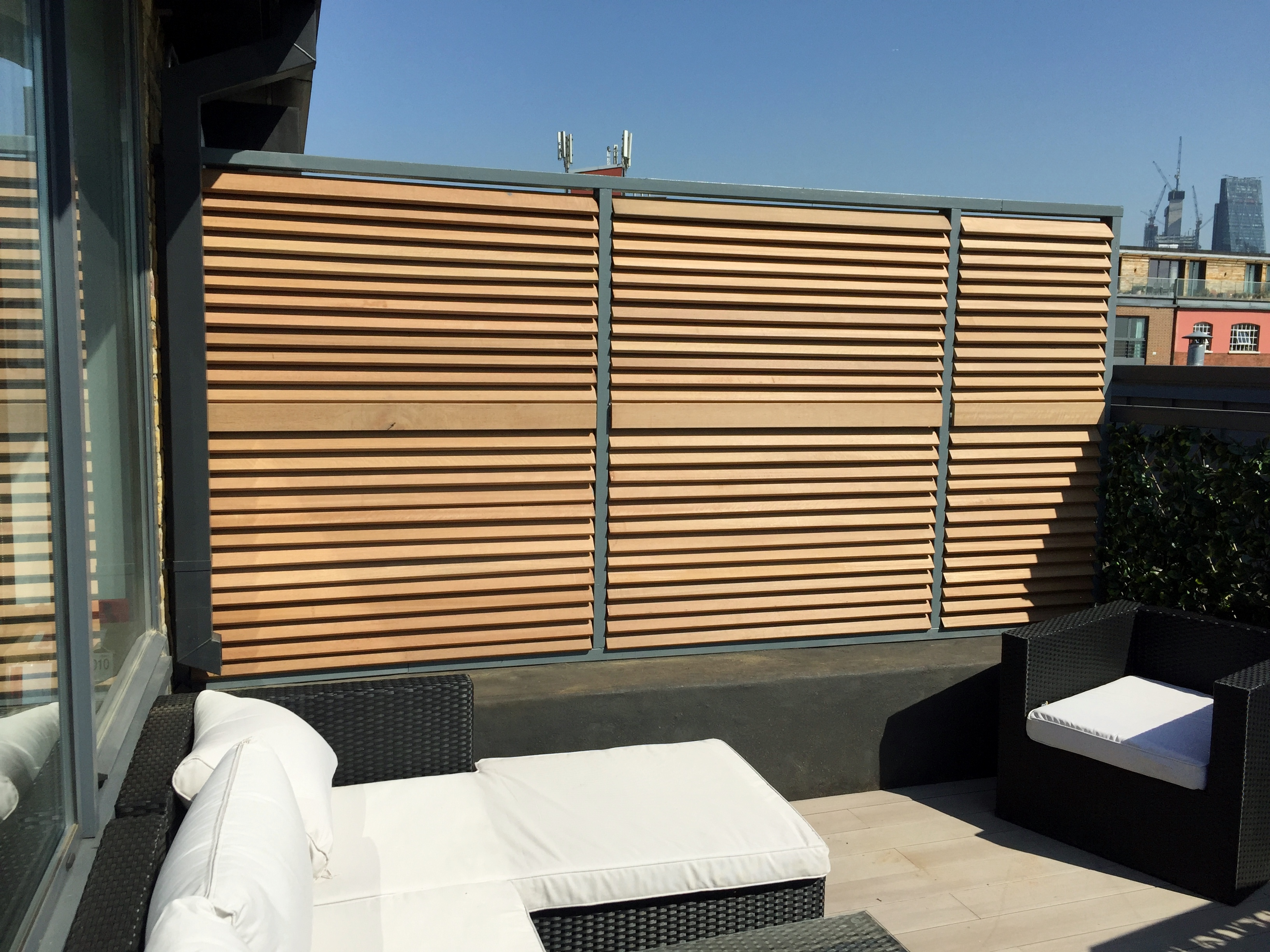 Slatted Hardwood Screen With Grey Wood Picture Frame
